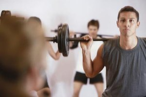 Man lifting weights in an exercise class.