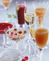 Jazz up inexpensive champagnes with flavored liquors and fruit juices.