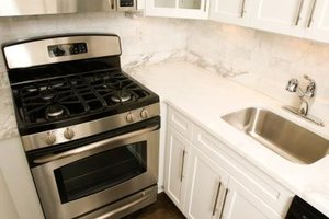 Clean your greasy stove top with common household products.