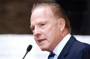Close-up of Frank Gifford speaking into microphone.