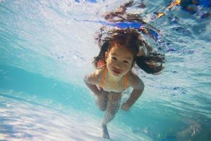 Young children can stand at the bottom of a shallow pool.