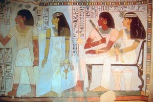 Egyptians in this painting are shown wearing semi-circular neck collars.