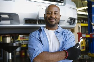 Auto service manager smiling in garage
