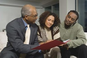 A married couple consults with a life insurance salesman
