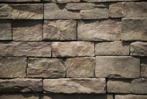 Stone walls add visual interest and texture to a driveway.