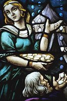 This stained glass image shows an Israelite woman collecting manna in a basket.