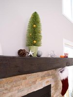Installing a mantle shelf is often the last step in completing a fireplace installation.