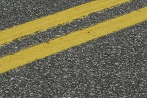 Asphalt contains toxins and carcinogens that may cause headaches, coughing and even cancer.