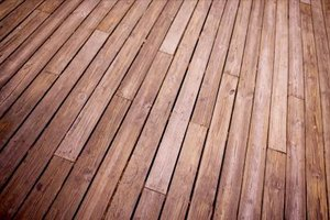 How to Glue a Rubber Membrane on a Wood Deck
