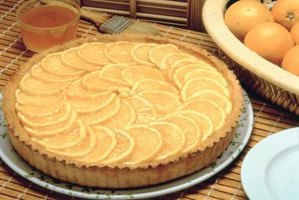 Top a lemon tart with thinly sliced lemons for an artful presentation.