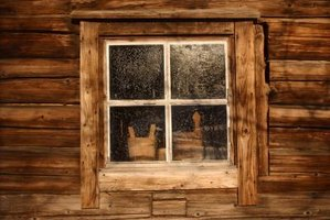 Log cabin window frames may match the exterior wood or take on a contrasting appearance.