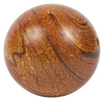 This is a perfect sphere carved out of wood.
