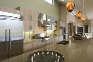 Amber glass pendant lights hanging above an island in a modern kitchen.