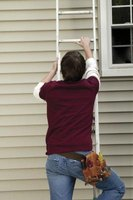 Ensure your ladder is on even ground when replacing siding on the second story.
