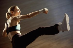 Side profile of a woman kickboxing
