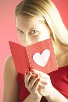 Make a homemade Valentine's card by gluing a heart shape onto the outside of the card.
