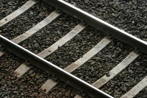 Railroad inspectors inspect track and maintain compliance with federal safety codes.