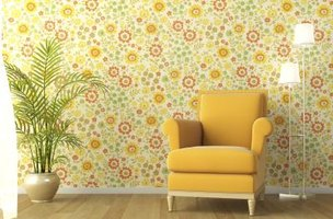 An accent wall with pretty floral wallpaper brings instant cottage style to a room.