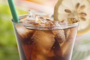 Serve the soda over ice with a slice or wedge of lemon.