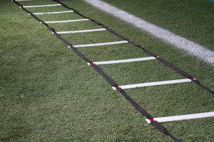Agility ladder lying on grass.
