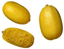 Bake spaghetti squash and create a main or side dish with meat, veggies or cheese.