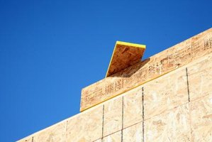OSB is used to sheath a building exterior in preparation for siding.