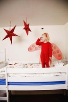 Make your child ladybug wings and get ready for make believe fun.