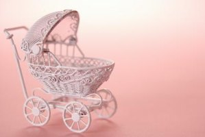 Start with a miniature baby carriage and fill or decorate it.