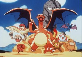 Pictured in the center is Chizard, the adult form of Charmander from Pokemon.