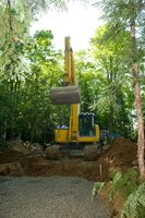 Heavy equipment simplifies the task of backfilling a basement.