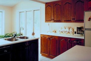 Add wood to your refrigerator so it matches the cabinets.