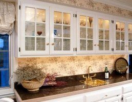 Use kitchen cabinets as the base and upper storage for a wet bar.