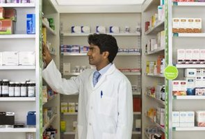A pharmacy technician assists the pharmacist.