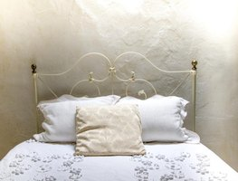 Hide the headboard's brass beginnings with spray paint.