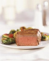 A properly rested, medium-rare filet has a rosy-pink interior.