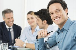 Man smiling in company meeting