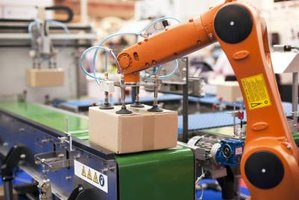 Robotic arm assisting in packaging process