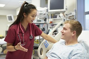 An ER nurse talks with a patient in a hospital.