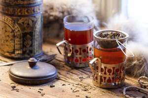 Brewing mugs of hot tea from loose tea leaves.