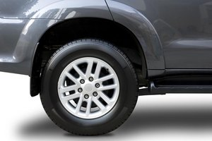 Rear wheels on a vehicle.