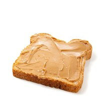 Peanut butter on white bread makes a good snack choice on a bland diet.
