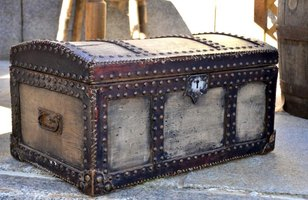 Old trunks and chests offer an alternative look to a traditional dresser for storing clothes.