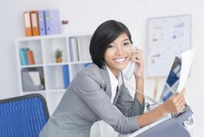 Administrative assistant on phone at front desk