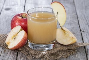 Drink raw apple juice for its higher vitamin C content compared to pasteurized juice.