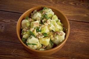 Hot German potato salad varies significantly from the traditional American picnic staple.