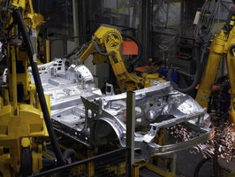 Car being designed and built in factory