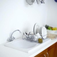 Wiping down your Corian kitchen sink after use helps prevent splotches.