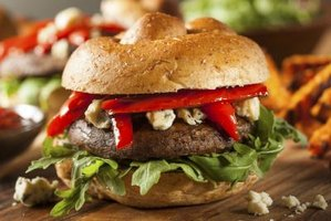 Blue cheese and red peppers add extra flavor to a portabella burger.
