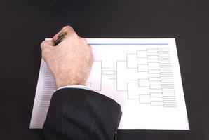 A man is filling out a bracket.