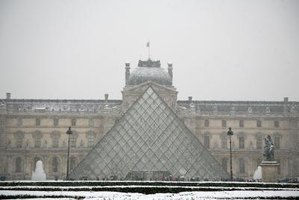 The Louvre contains a glass pyramid in front.
